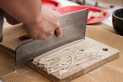 Cutting soba from handmade dough