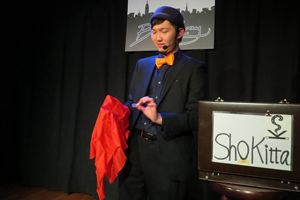 Sho Kitta, magician performing for an audience.